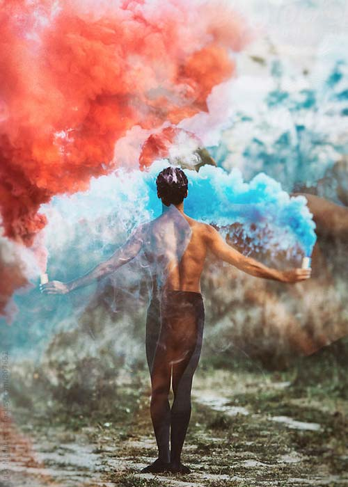 man standing in front of red, white and blue clouds